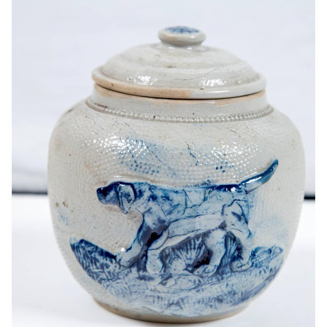 19th century blue glaze stoneware covered jar. Originally used as a humidor to store tobacco. Raised design in cobalt...