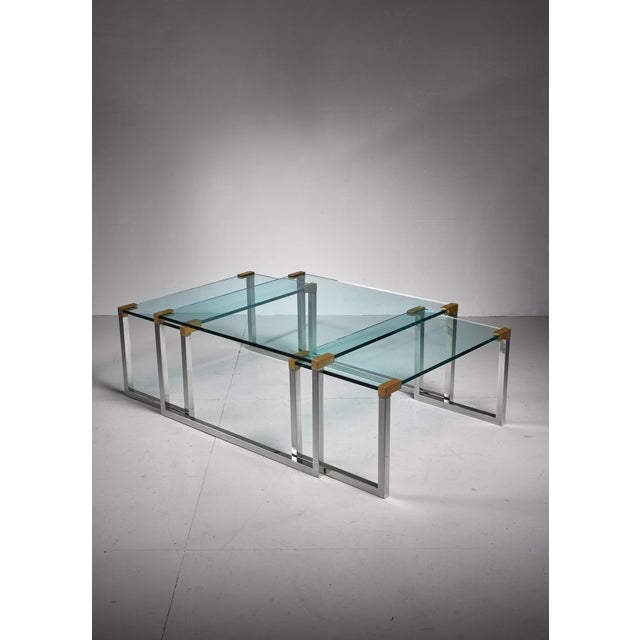 A set of three modular side or coffee tables by Dutch-Hungarian designer Peter Ghyczy. The tables are made of a chrome and...