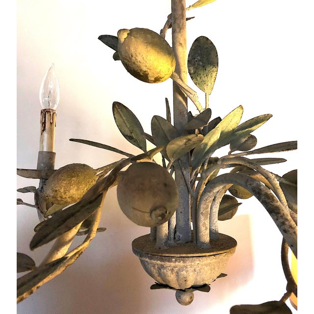 This toleware lemon chandelier has all the vintage charm of an antique without the risks associated with old wiring....
