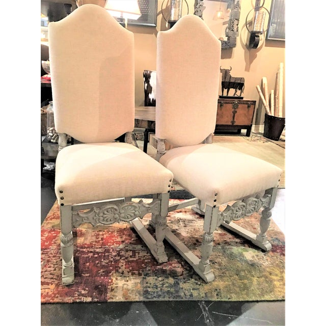 Pair of linen upholstered grey distress painted fruit wood side chairs. Professionally upholstered in a beige linen blend...