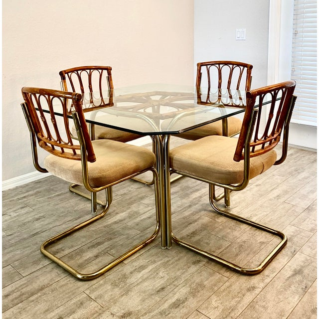 Vintage Mid century modern Rattan and brass dining Set in mint condition. Solid rattan cane and tan cushions. Set includes...