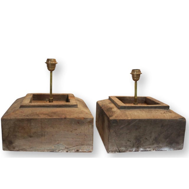 Pair of heavy rustic lamps custom constructed from salvaged antique hewn wood blocks by architect Jeff Jones. Each lamp...
