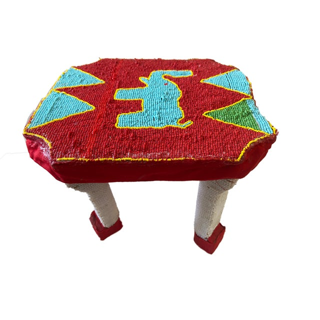 Cute and very decorative small low beaded stool from the Yoruba people Nigeria depicting a blue elephant on the top ,on...