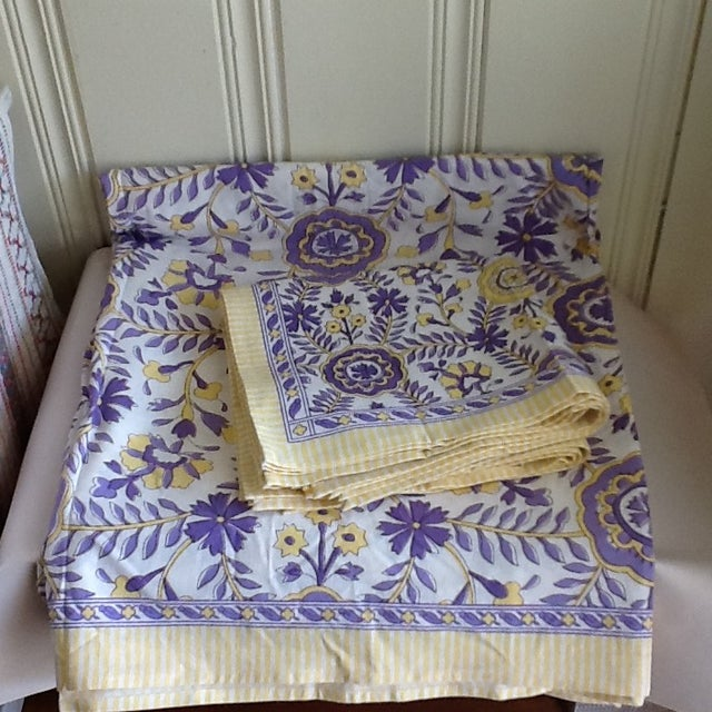 Williams Sonoma tablecloth and cloth napkins set of eight altogether. Seven cloth napkins and matching lavender, yellow...