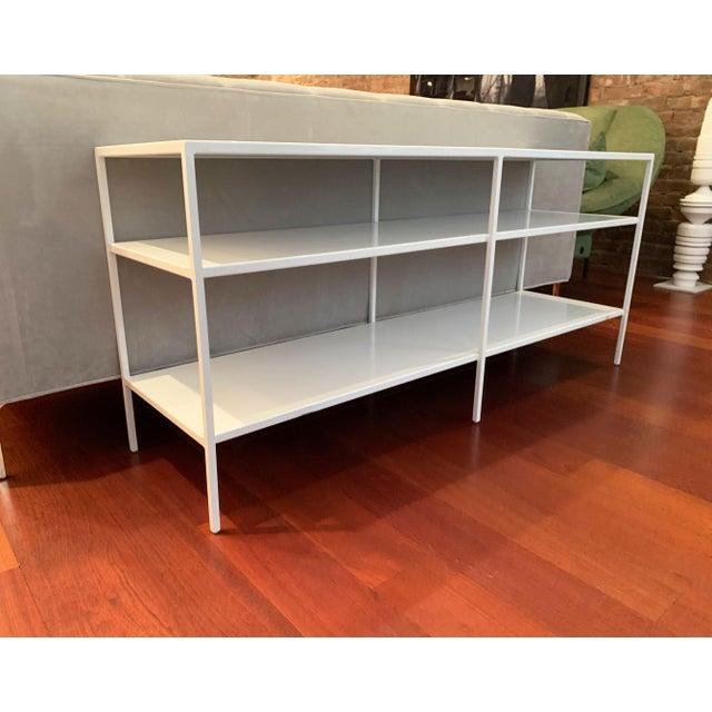 "Sleek modern white powder coated shelf. Originally purchased from Room & Board. Top shelf clearance: 6"" Bottom shelf..."