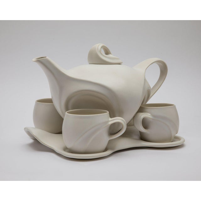 Space Age White Porcelain Teaset by Peter Saenger (Active 1970-Present), comprising a teapot and cover, four mugs, four...