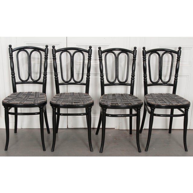 A superb set of four ebony bentwood side chairs by Thonet. Michael Thornet is credited for creating the iconic bentwood...