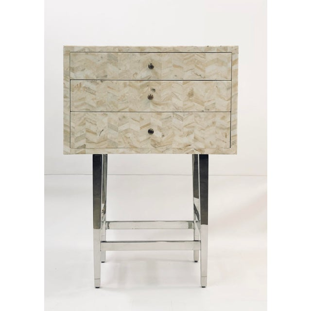 The creamy herringbone pattern along this drawer chest resembles the intricate etchings of the marble floors of Italian...