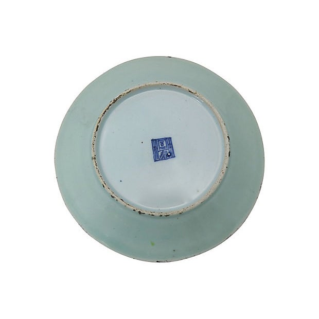 Antique Chinese celadon Wucai serving plate with hand-enameled garden and butterfly scene. Signed on the back, hand-...