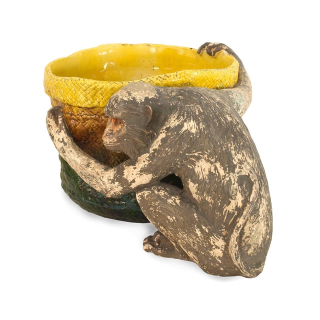 English Victorian (Majolica) porcelain green and yellow basket form jardinière being held by a seated monkey figure (AS...