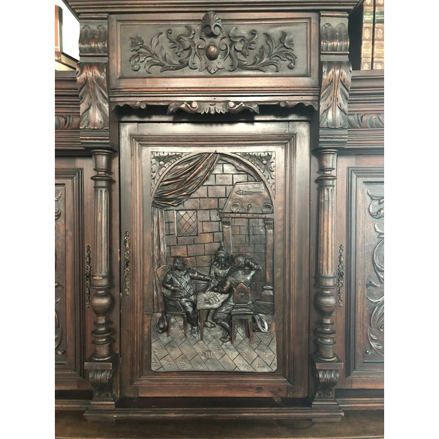1800's carved antique storage cabinet is an awesome piece to make a statement for any room. Made of solid wood and hand...