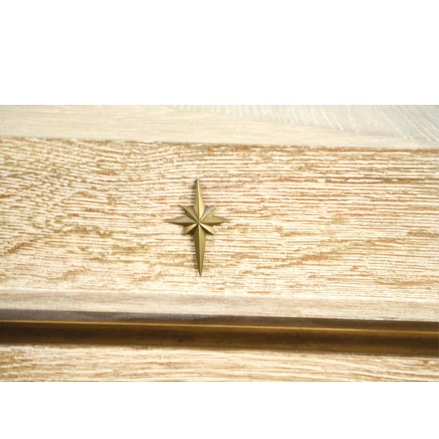 Vintage cerused oak chest of drawers with brass detail. This piece is made incredibly well and in excellent condition.