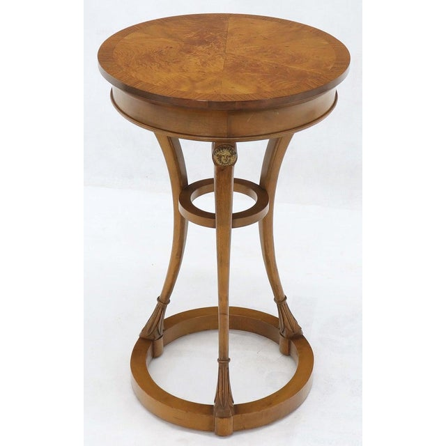 Round burl wood tops neoclassical guerdons pedestals shape tables. Baker quality.