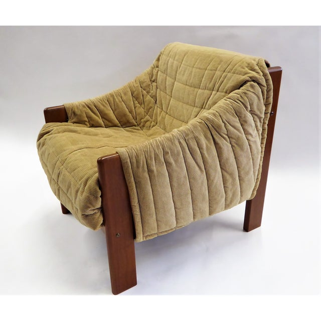Solid teak and a quilted Chenille wrap cover highlight this armchair from Domino Møbler. A cozy 1970s Lounge chair from...