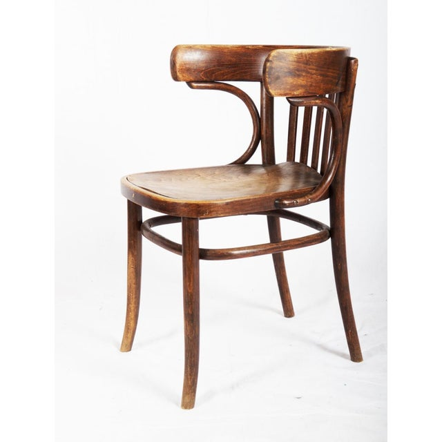 Michael Thonet designed this bistro dining chair during the 1920s. It was manufactured in Austria. It is made from beech...