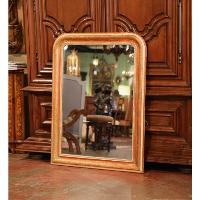 This large, antique wall hanging mirror was crafted in France, circa 1860. The traditional Louis Philippe mirror features...
