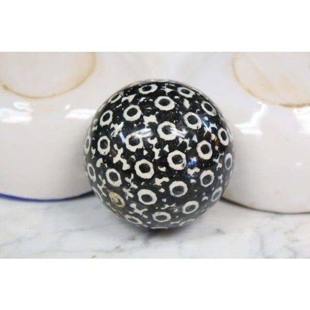 Porcelain Victorian carpet ball in black and white circle pattern. A decorative curiosity.
