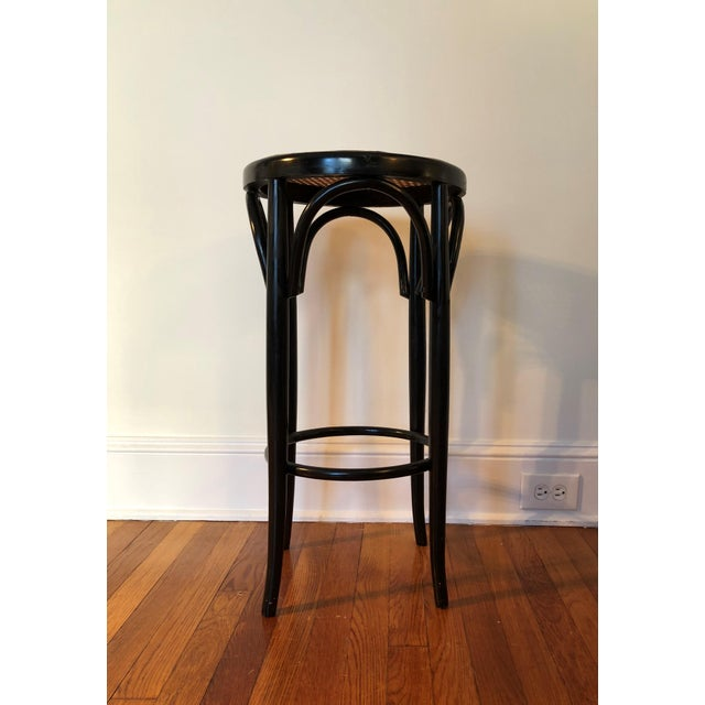 Original black bentwood cafe or counter stool. Caning in excellent condition. Some scuffs and scratches to frame. See pics...