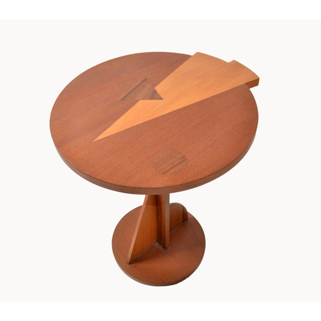 Stylish 1970s Italian Side or Cocktail Table in Mahogany Wood, decorated with Marquetry on the Top. Unique Pedestal Base...