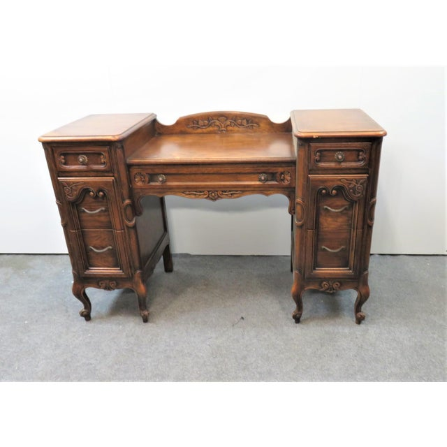 Louis XV style vanity, solid oak, carved floral accents, 3 drawers on each side, a single drawer in the center. Made by...