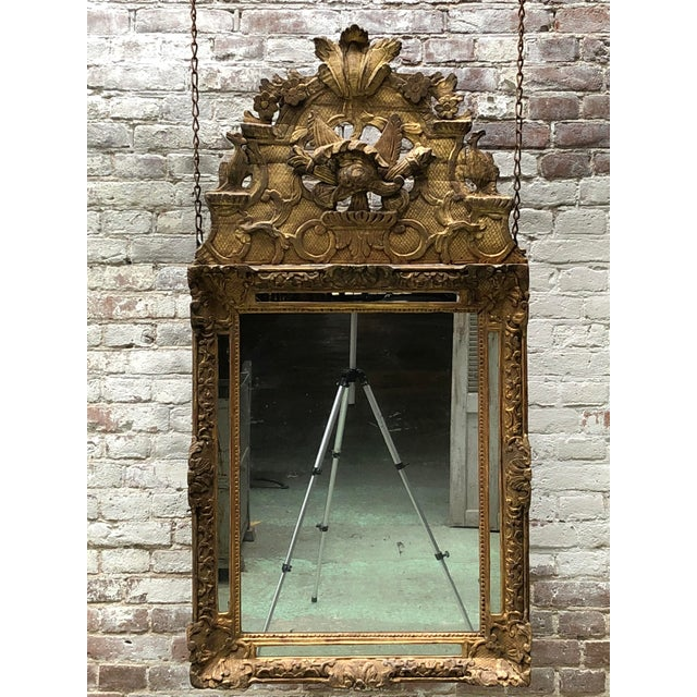 Carved gilt wood mirror, Louis XIV. Early 18th Century ,Provenance France This Louis XIV mirror is exuberant, symmetrical...