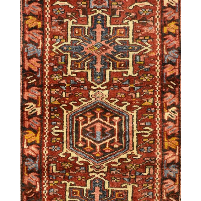 This beautiful rug is hand made, made in Iran. It features a pattern in a vibrant combination of red, navy, blue, white,...