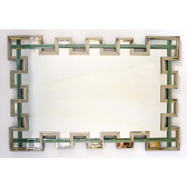 An exclusive Venetian rectangular mirror in Murano glass, entirely handcrafted in Italy with a unique modern architectural...