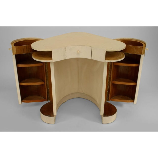Italian Art Deco white parchment deminuative triangular form lady's dressing table with a drawer centered by 2 side...