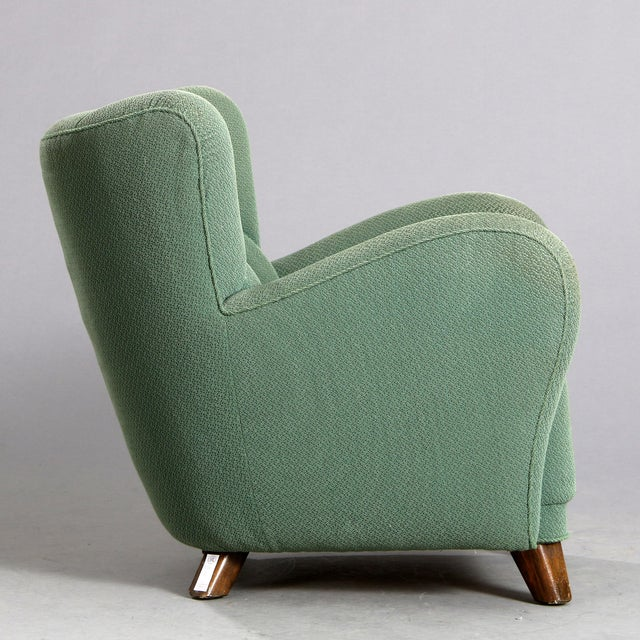 Stylish 1940's Danish cabinetmaker easy armchair with stained oak legs. Seat, sides and back upholstered with green...