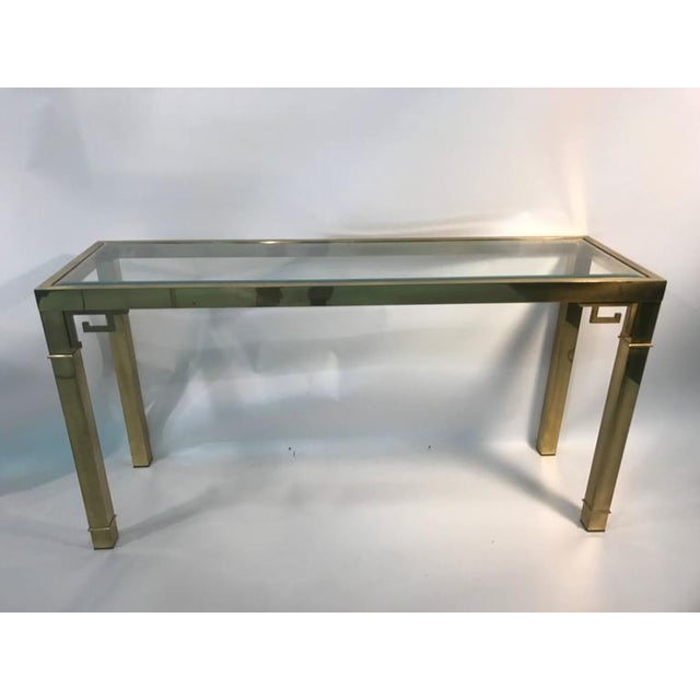 An elegant, Italian solid brass console table with Greek Key design, circa 1970. Good vintage condition.