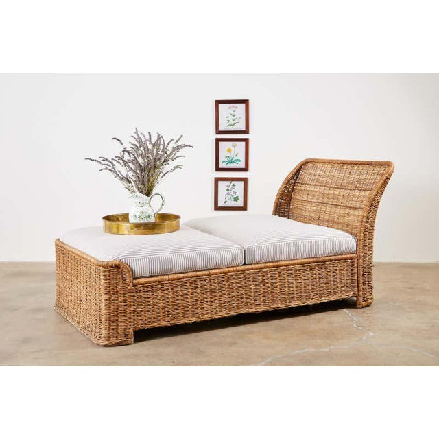 20th century wicker daybed or chaise lounge featuring a sleigh style form. Constructed from a metal frame covered with...