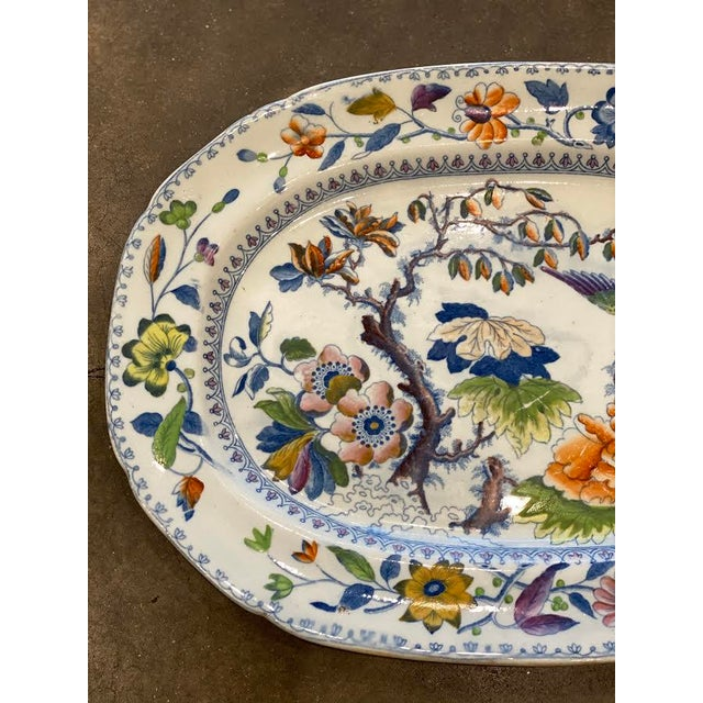 """This is a beautiful antique Chinoiserie platter. The painted serving piece in the """"Flying Bird"""" pattern features a..."""