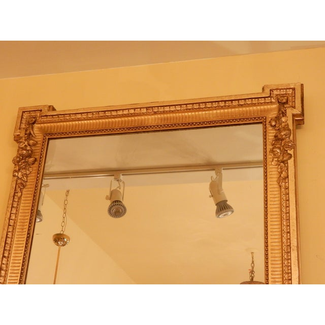 Tall Louis XVI gold gilt mirror, 19th century. Has original mercury glass and wood paneled back.