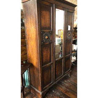 Early 20th Century Folk Art Carved Armoire/Wardrobe With Beveled Mirror Door Preview