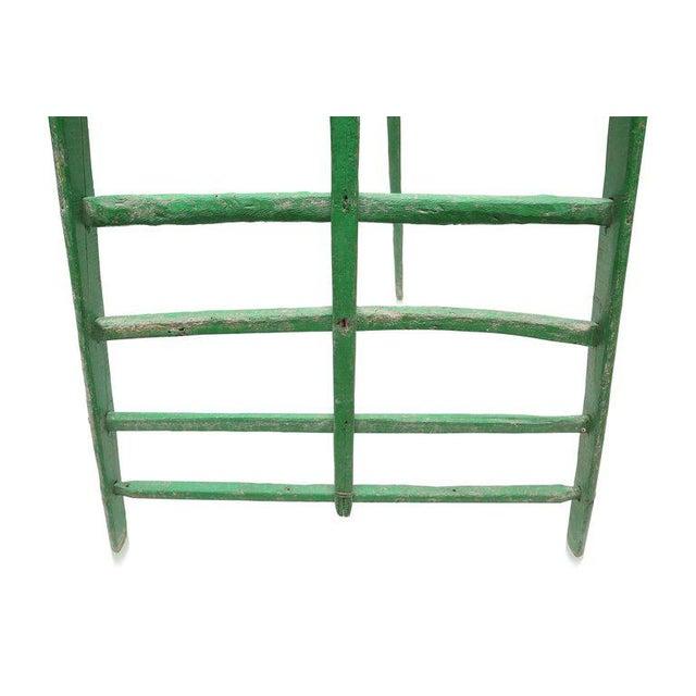 Tall original green lacquered fruit ladder, France, 19th century, 'objet trouve´.Measures: H 293 cm W 146 cm.