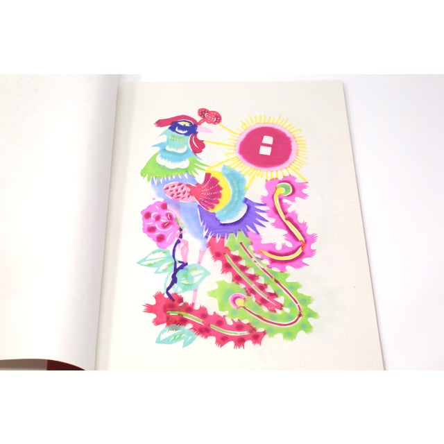 A set of eight vintage, handmade and hand-colored paper cuttings, each depicting a stylized, colorful bird and flowers....