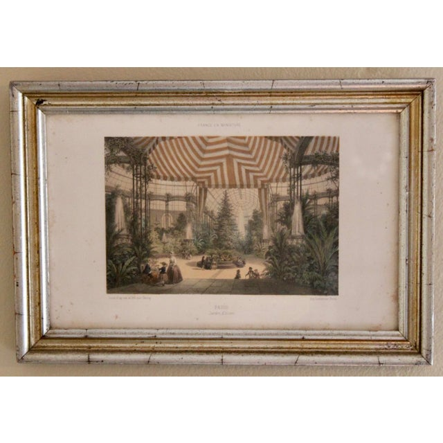 A lovely pair of French prints depicting scenes of an older France. One print shows an aerial view of a quaint French...