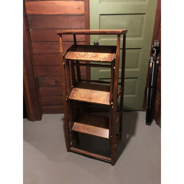 Early 20th century American Metamorphic library ladder steps. Fold neatly for storage or to double as a pedestal. Wear...