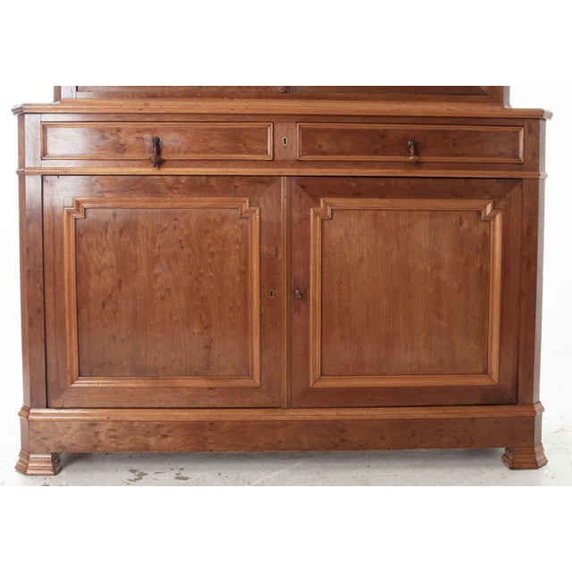 French Louis Philippe bibliotheque / buffet a deux corps in birds eye mahogany. Wonderful crown over bibliotheque of two...