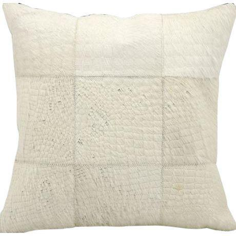Offering two hand cut natural hair on hide and leather pieces skillfully sewn to create elegant, high fashion pillows....