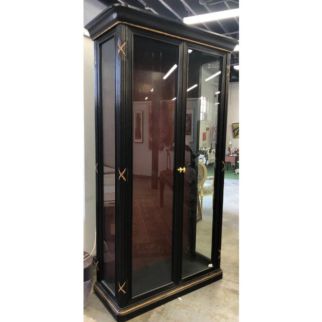 Pair of Erika Brunson for Randolph & Hein Black & Gold Vitrine Showcase Cabinet W Red Interior. Contents of the cabinets...