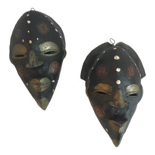 1970s African Hand Carved Masks With Brass and Coin Insets - a Pair For Sale