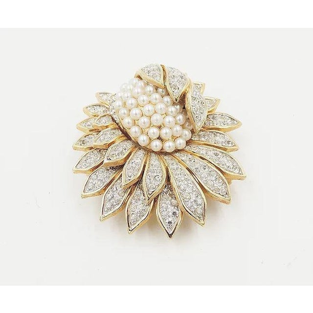 """1960s goldtone and silvertone pavé rhinestone and faux-pearl brooch with security clasp. Marked """"Jomaz."""" Measures: 2..."""