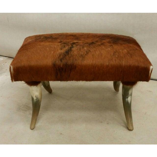Custom Longhorn Ottoman made of cowhide and longhorn.
