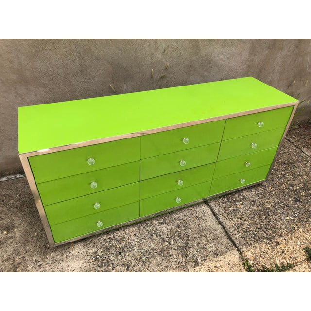 Vibrant green lacquered Thomasville lowboy dresser. Shiny aluminum trim with round lucite pulls and green wood grain...