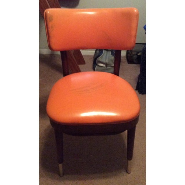 "This is a great Shelby Williams vintage retro orange vinyl side chair. The seller says: ""This chair is from the early..."