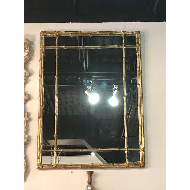 Vintage faux bamboo wall mirror with lovely original gold finish. Comes ready to hang on your wall.