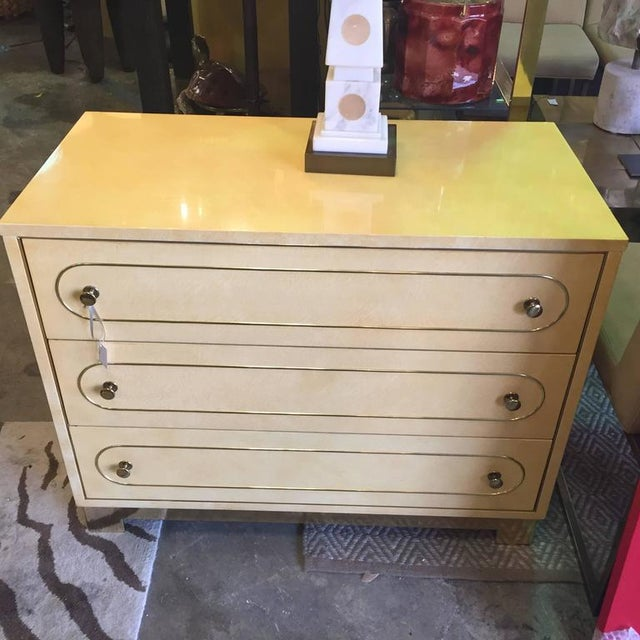 Pair of Romweber lacquered oak chest of drawers each having three drawers with applied brass trim upon a brass plinth....