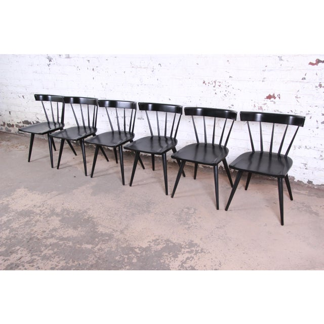 A gorgeous set of six ebonized mid-century modern spindle back dining chairs from the Planner Group line designed by Paul...