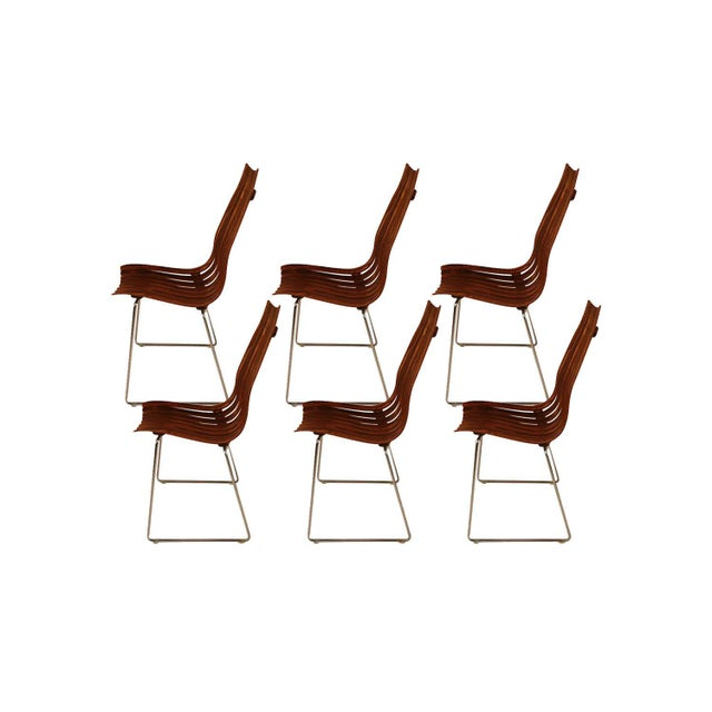 "A rare set of six stunning Mid Century Modern, stackable, high back, rosewood, senior, dining chairs part of the ""Scandia""..."